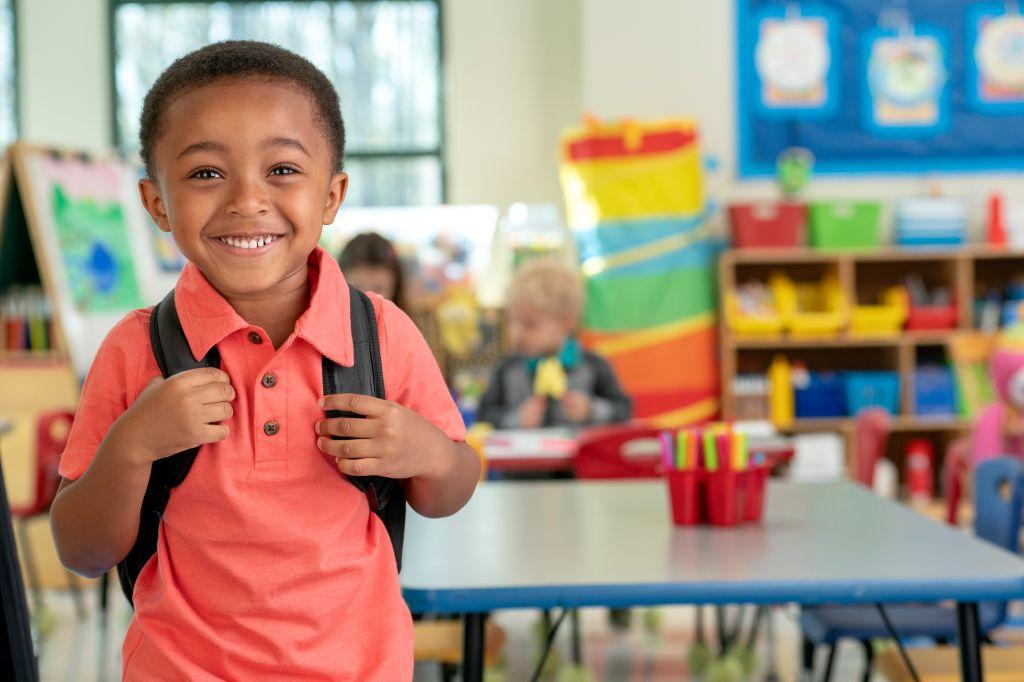Happy Kindergarten Student in Classroom