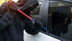 Car theft - thief trying to break into the vehicle.